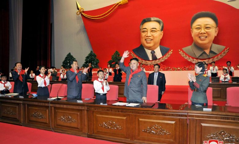 Kim Jong Un waving back to cheering participants in the Seventh Congress of the Korean Children's Union in June 2013