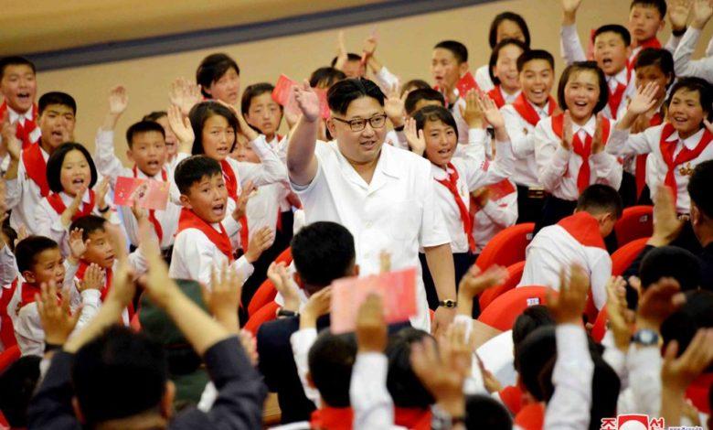 Kim Jong Un with KCU members in June 2016