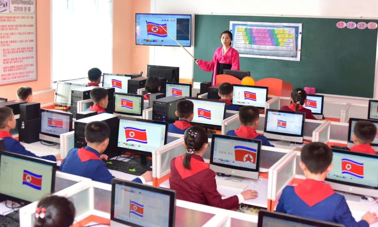 Schoolchildren studying to their heart's content under the universal 12-year compulsory education system