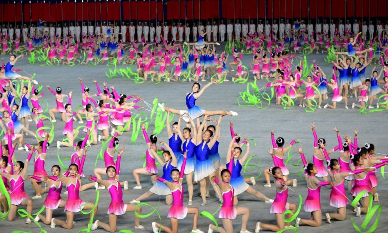 Schoolchildren participating in the grand mass gymnastics and artistic performance