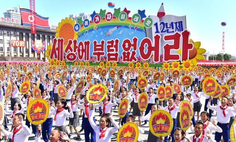 The KCU members acclaiming the respected Comrade Kim Jong Un